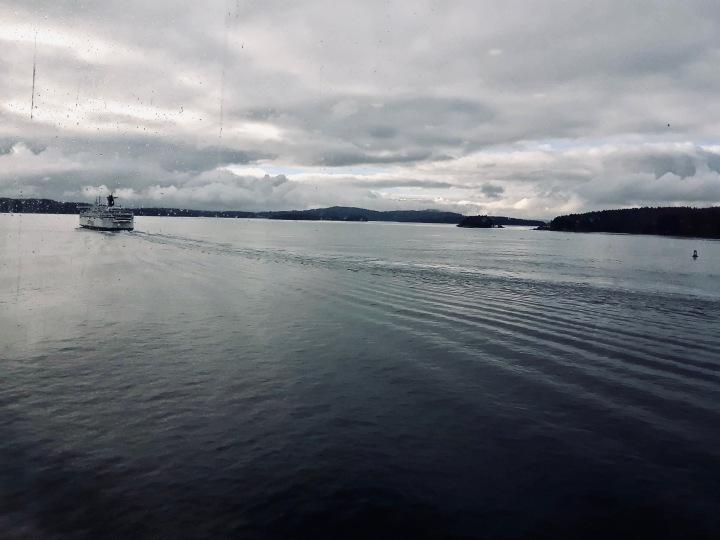 A calm ferry ride, viewed through rain-splattered windows